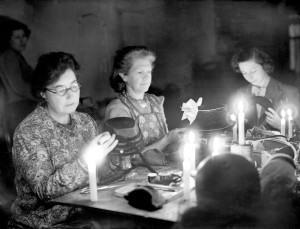Making hats by candlelight during London electricity cut in Oxford Street - 10-February-1947. Image No. 10551583  Planet News / Science & Society Picture Library