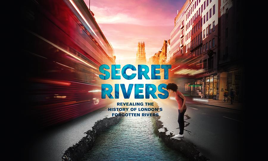 Secret Rivers - revealing the history of London's forgotten rivers. Someone looks down into a river running through the middle of a road.