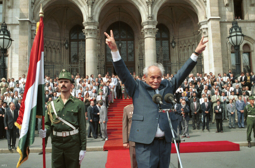 Newly elected President Árpád Göncz greeting the crowd in front of the Hungarian Parliament in 1990. Göncz was imprisoned in 1957 for his participation in the 1956 revolutionPhoto by Csilla Cseke, MTI
