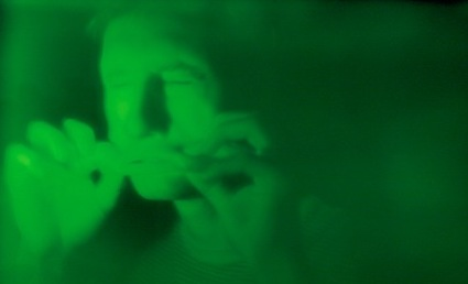 An image of a man bathed in green light